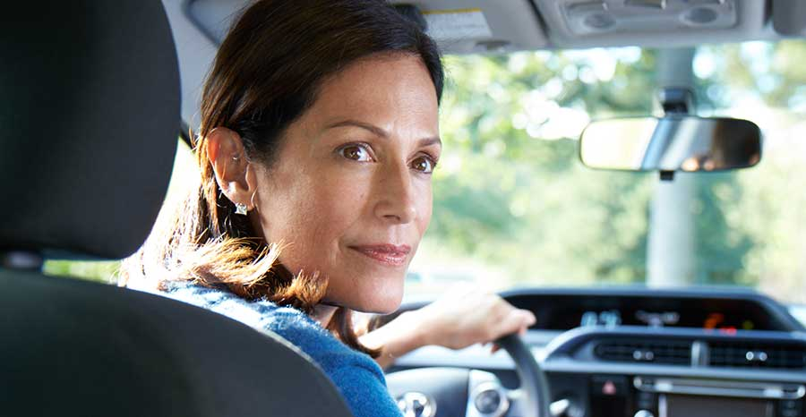 A women confidently driving the car