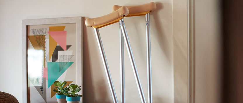A pair of crutches up against a wall